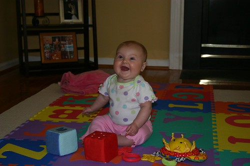Anna playing on her playmat