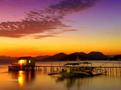 Sunset in Coron, Palawan Philippines (chona_p) Tags: sunset boat interestingness bravo philippines cottage explore coron palawan supershot flickrsbest mywinner beyondexcellence travelerphotos pinoyconnect thegoldenmermaid