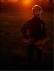 Getting his breath (Kirsten M Lentoft) Tags: light boy sunset topc25 topv111 backlight child rightplacerighttime abigfave anawesomeshot momse2600 ibeauty madz2600 kirstenmlentoft