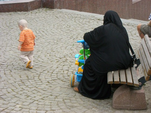 Woman wearing chador with son