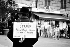 Strano (Iguana Jo) Tags: bw italy man strange sign bn uomo cartello strano reggioemilia adrianograzioli