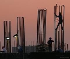 constructing silhouettes (jobarracuda) Tags: sky lumix workers construction silhouettes constructionworkers orangesky bonifacio fz50 panasoniclumix dmcfz50 anawesomeshot superaplus aplusphoto jobarracuda fotocompetition fotocompetitionbronze