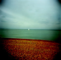 I am sailing.... (microabi) Tags: beach holga brighton mood cloudy toycamera pebbles bythesea iamsailing butimhappy smallwhiteboat asatmyfavplace