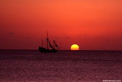 Pirate's Ship on the Horizon (Fevi in Pictures) Tags: pictures sunset orange beach silhouette island islands ship photographer photos pics grand seven pirate cayman jolly roger yu mile governors fevi caymangirl