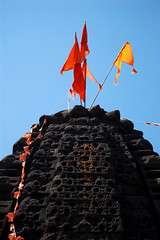 harishchandragad (flaming coppercat) Tags: orange india temple flags ahmednagar malshejghat harishchandragad diti kokankada flamingcoppercat