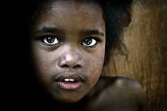 Through the eyes of terror... (carf) Tags: poverty girls light brazil girl brasil kids dark children hope kid community support child risk darkness naturallight forsakenpeople esperana social impoverished underprivileged afrobrazilian altruism eldorado shanty haunting favela development prevention flvia fright frightening atrisk mundouno