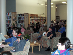 Crowd watching Coffeehouse @ the Library performer