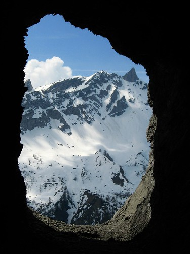 A hole in the wall in tunnel leading up to Col du Sanetsch, Switzerland