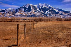 Fenceline to the Mountains (Jeff Clow) Tags: travel vacation mountains fence landscape bravo montana searchthebest blended soe hdr paradisevalley multiexposure fenceline photomatix abigfave superbmasterpiece cjeffrclow