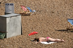 The sun commits murder on Brighton beach (Shaunumb) Tags: uk sun beach flesh death brighton kill skin body sunny just bikini murder suntan around joking