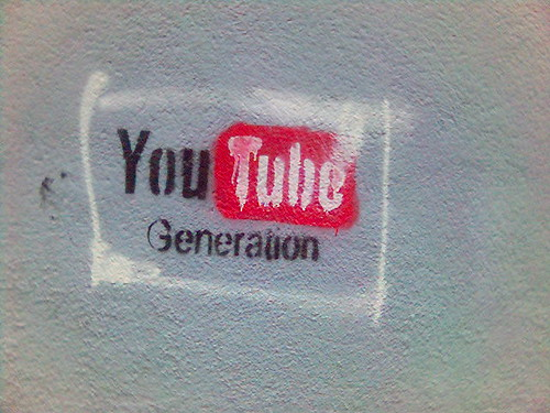 YouTube Generation graffiti on a cement wall.
