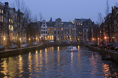 Dusk at the Amsterdam canals (macropoulos) Tags: holland reflection water netherlands amsterdam geotagged lights canal 500v20f dusk 500v50f canonef35mmf2 1000v100f topf100 supershot 1500v60f 1000v40f abigfave canoneos400d 30faves30comments300views 50faves50comments500views travelerphotos geo:lat=52366828 geo:lon=4888262