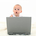 Baby Girl Working On Laptop por redactie ikvader.nl