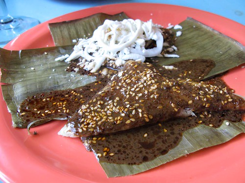 corundas (triangular tamales) with mole at Maiz.jpg