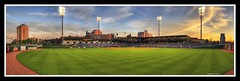 Field of Dreams (sunsurfr) Tags: blue sunset sky people panorama building green grass architecture clouds photoshop lights nikon colorful downtown baseball stadium pano alabama structure explore biscuits fans d200 hdr yello stands rightfield centerfield photomatix tonemapping nikonstunninggallery biscuitsbaseball superaplus aplusphoto moontgomery sunsurfr