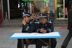 Tibet0035.JPG (robot glue) Tags: china family vacation mountains market police tibet 2007 sittin