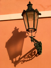 Casting A Distorted Shadow in Prague (david.nikonvscanon) Tags: world camera original shadow lamp digital photoshop canon photography photo search saturated photographer prague image postcard creative commons icon images photograph luck lucky pixel cre