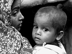 Indian portrait...... (Monia Sbreni) Tags: 2005 street travel portrait people bw india love monochrome look asia strada child noiretblanc zwartwit indian profile daughter mother bn persone sguardo mamma indie schwarzweiss protection viaggi kolkata ritratto bengal amore pretoebranco bianconero calcutta biancoenero reportage bengali bambino profilo svartvitt blackandwithe bengala figlia blueribbonwinner protezione supershot 35faves p1f1 aplusphoto diamondclassphotographer sfidephotoamatori worldphotodoc2005 westbengala sbrenimonia moniasbreni espressionidellanima