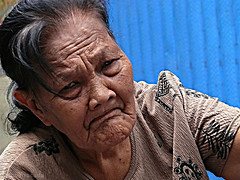 cigarette grandma (jobarracuda) Tags: lumix grandmother lola filipino oldlady oldwoman pinoy fz50 panasoniclumix  abigfave dmcfz50 cigarettevendor superaplus aplusphoto jobarracuda superhearts