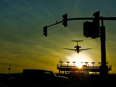 Sunset Landing (cyanatic) Tags: california city sunset urban field plane airplane airport downtown sandiego aviation jet landing lindbergh socal southerncalifornia airstrip peopleschoice may5 aviationart cyanatic abigfave 24hoursofflickr simplyperfect