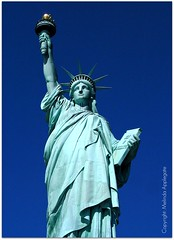 The Magnificent Statue of Liberty (Scandblue) Tags: newyorkcity blue sculpture usa beautiful america liberty unitedstates landmark patriotic icon torch stunning immigrants statueofliberty beacon breathtaking magnificent libertyisland ladyliberty newyorkharbor emmalazarus givemeyourtiredyourpoor motherofexiles thenewcolossus mightywoman worldwidewelcome