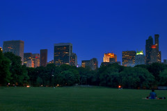 Central Dusk_7020 (Punk Dolphin) Tags: newyorkcity blue green grass buildings lights dusk centralpark manhattan midtown greatlawn essexhouse gebuilding sheepsheadmeadow