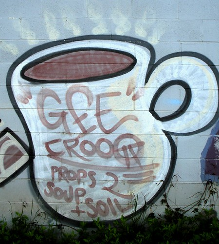 "graffiti of a cuppa coffee -- contains the spray-painted words: ""props to soup + soil"""