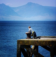 Contemplation (gms) Tags: contemplation gazing kneeling blue pier memorium diver water arran catchycolors topv111 wow tccomp039