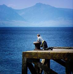 Contemplation (gms) Tags: contemplation gazing kneeling blue pier memorium diver water arran catchycolors topv111 wow tccomp039