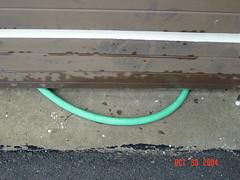 DSC05613 (Faded Photograph) Tags: green home concrete pavement garage things hose end appliances garagedoor redo onecentshot