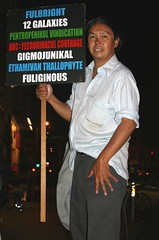 Frank Chu (Thomas Hawk) Tags: sanfrancisco california city usa man sign holding unitedstates unitedstatesofamerica northbeach abc galaxies coverage frankchu vindication 12galaxies northbeachdistrict sothisisamerica pentropenikol yecrodinacul gigmojunikal ethamiwan thallophyte fuliginous