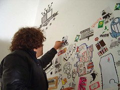 Pasting up (Supersentido) Tags: galeria normal sticker exhibition pece chile supersentido