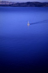 Tiny (Walter Quirtmair) Tags: 2005 blue sea film topf25 water boat santorini greece caldera ripples swq takenbywalter eos300 fujivelvia 30faves30comments300views frhwofavs