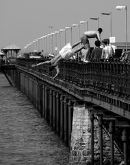 Leap Of Faith (Monster.) Tags: bw pier jump dive perspective documentary isleofwight jumper diver itsongselection1 leap iow rydepier perfectingladolcevita itsong–nikond70