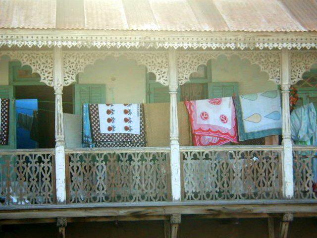 House with wooden lace balcony, Stonetown, Zanzibar, Tanzania