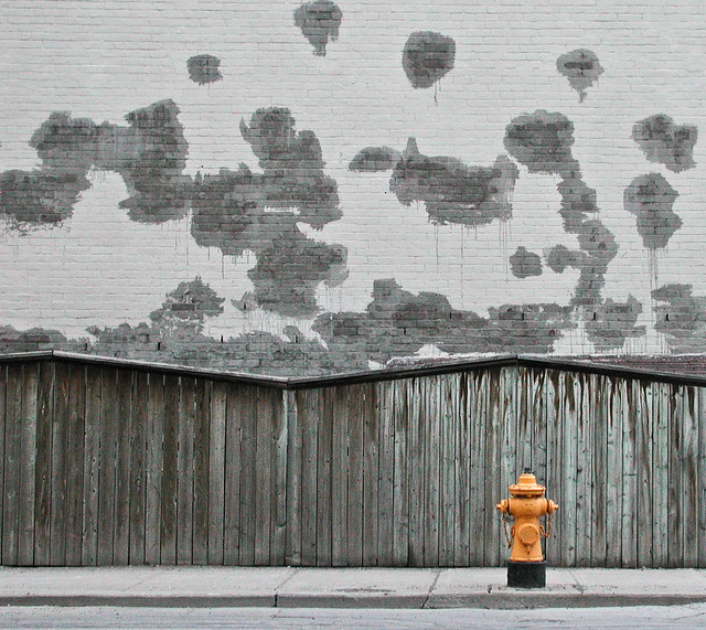 Hydrant against grey wall