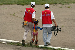 The Tiniest Wrestler (MykReeve) Tags: mongolia ulanbator ulaanbaatar naadamfestival naadam openingceremony cameramen wrestler child boy stadium