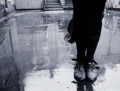 Rainy (BosseB) Tags: bw feet wet rain backyard shoes canonae1