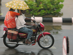 Motorcycle Riders (debra booth) Tags: india rain motorcycles scooter pan umbrellas panning pondicherry panned debrabooth