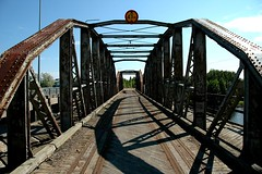 Kotka: Closed Bridge Up Close (dumell) Tags: wood railroad bridge metal closeup suomi finland geotagged rust iron track finnland shadows traffic decay edited steel railway transportation rails bolts corrosion decommissioned kotka finlandtour2005 industrialisation geolat6048569 geolong2696912