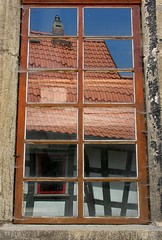 Reflections of roofs (:Linda:) Tags: blue roof red chimney sky house reflection building rot window glass wall architecture germany tile wooden village timber fenster spiderweb row symmetry thuringia symmetrical spinne reflexion schornstein spinnwebe halftimbered fachwerk fachwerkhaus timberframing henfstdt timberconstruction reflectiononwindowpane
