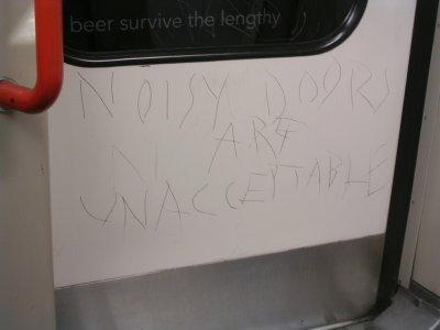 Etched Graffiti on the Central Line by Geoff