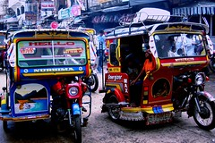 downtown traffic (Farl) Tags: travel public colors downtown traffic tricycle philippines utility vehicle sulu mindanao tawitawi tricycles bongao