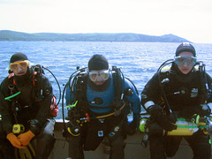 3 ready to dive (squeezemonkey) Tags: uk sea coast boat divers diving drysuit kittedup othree