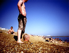 Buried 2 (kagey_b) Tags: 2005 uk sea film beach headless seaside interestingness lomo lca xpro lomography crossprocessed xprocess funny brighton kevin buried britain head stones july explore mostinteresting meredith fools jessops100asaslidefilm e6 lomokev decapitation carmbler i500