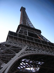 From below the Tower - slightly skewed (Tanya in BNE) Tags: paris france tower digital canon cards interestingness holidays landmarks scout eiffel moo ixus printing trips digitalcamera touring contiki tourgroups interestingnessaug2005 moocards