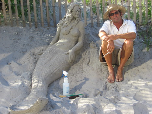 Man sitting next to a Mermaid. phto: iirraa, flickr
