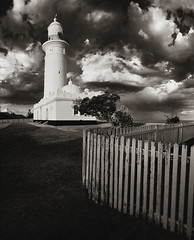 macquarie lighthouse - summer storm (Paul Gosney) Tags: sunset bw lighthouse storm clouds fence sydney dramatic australia nsw late macquarie stitched picket southhead paulgosney acmp paulgosney