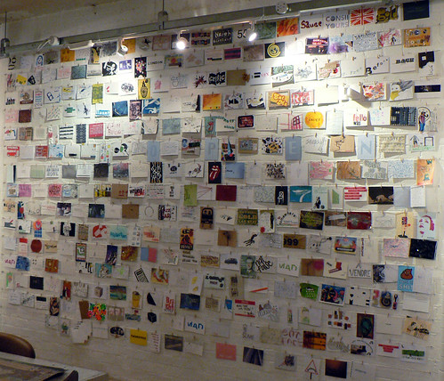 Wall of postcards at the Homestead Gallery: Day 1