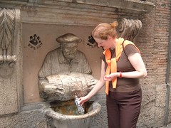 Sue at a drinking fountain in Rome